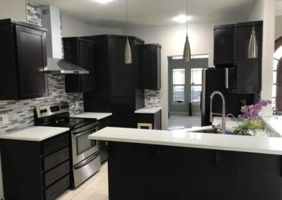 Dark Brown Cabinet with White Counter Top Kitchen 2