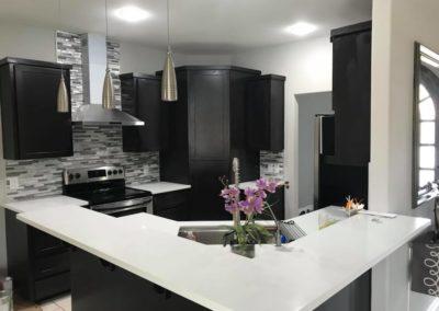 Dark Brown Cabinet with White Counter Top Kitchen