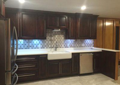 Kitchen Dark Brown Cabinetry with White Countertop Design