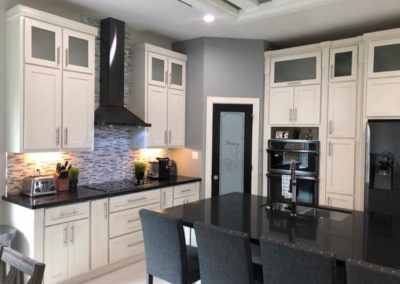 Modern White Cabinet Black Counter Top Kitchen Design