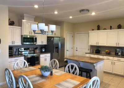 White Cabinet with Brown Counter Top Kitchen Design